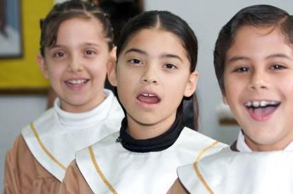 Happy Children singing in choir